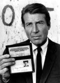Efrem_Zimbalist_Jr._Lewis_Erskine_displays_FBI_credentials_1969