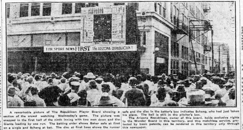 Crowd_watching_World_Series_Heard_Building_1921