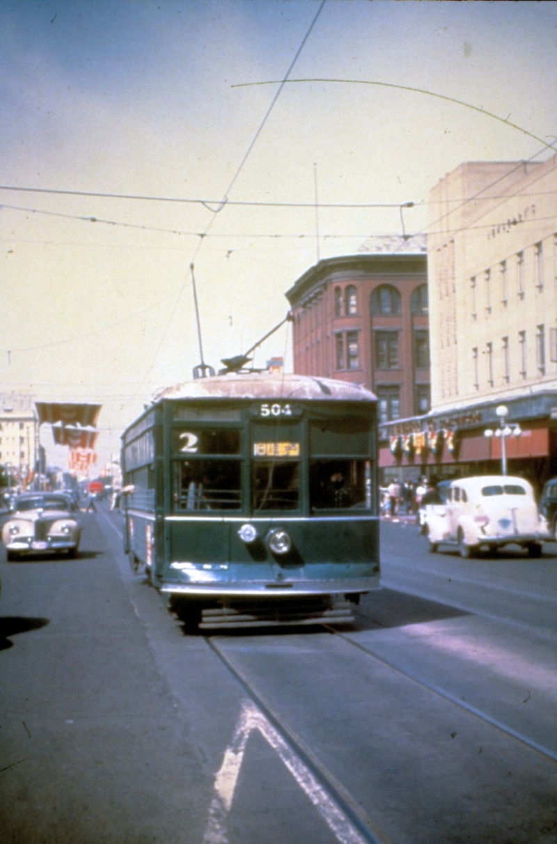 Washington_looking_west_towards_1st_Ave_trolley_street_car_1930s