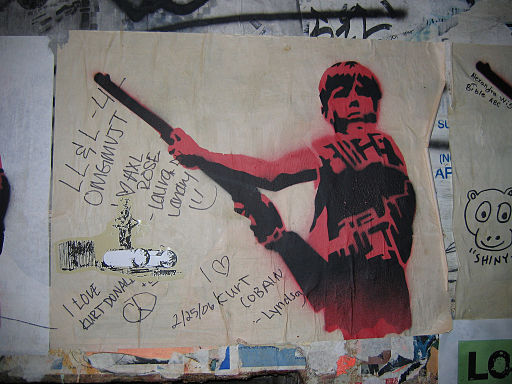 Graffiti_of_boy_with_rifle,_Seattle