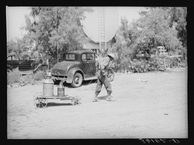 Man hauling water 1940